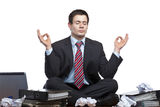 stressed-business-man-meditates-desk-office-20298529
